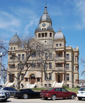 Denton County Courthouse located in the center of historic downtown Denton. Designed by W. C. Dodson in 1895 the structure cost $150,000 and opened in 1897. The county and town were named in honor of John B. Denton, frontier preacher, and lawyer buried on the east lawn.