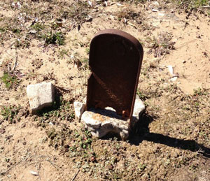 Cast iron grave marker in Hunt County