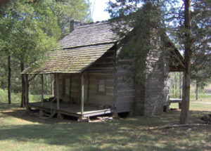 Frontier log cabin much like those built in the Red River region of Northeast Texas  until statehood in 1856.